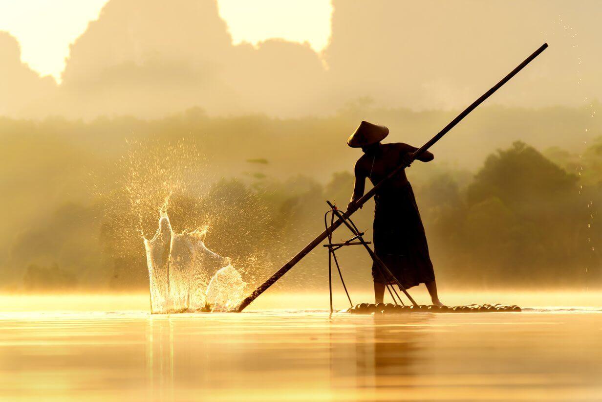 Fischer im Wasser